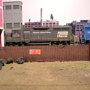 Weathered GP-35s pulling cut of cars down track 1