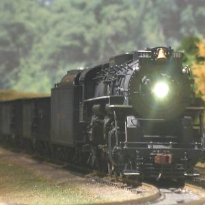 NKP 765 throttles up with a full 70 car coal drag
