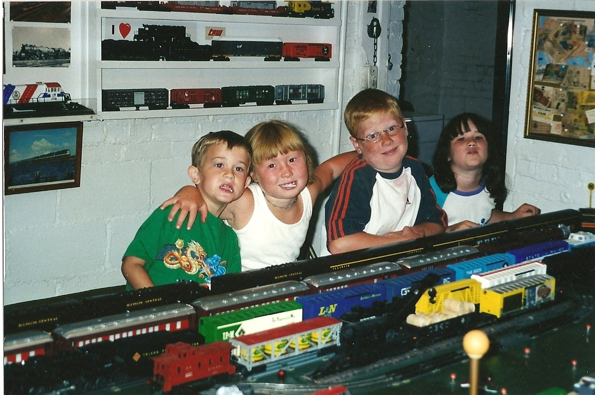 jenna, dan, jared and mary with trains.jpg
